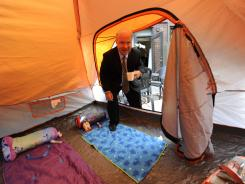 John Moser of Affinia Hotels with a tent outside a room at the NYC Affinia Gardens Hotel.