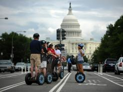 A Segway tour group stops on the new Pennsylvania Avenue bicycle lanes near the US Capitol for some narration from their guide in August 2010 in Washington.
