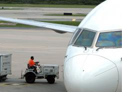 A plane sits at a gate at Orlando International Airport.