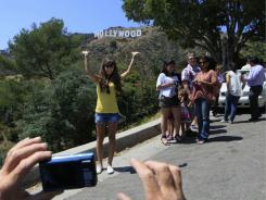 Tourists have flooded neighborhoods with a view of the Hollywood sign in Los Angeles, since GPS and internet maps have made it easier to find.