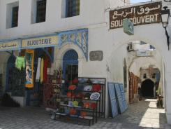 An empty market is seen in the town of Houmet Souq on the island of Djerba, Tunisia. The cafes in the plazas and shaded archways of the market, which would normally be bustling at this time of year, are deserted as the local economy suffers from the disappearance of foreign tourists.