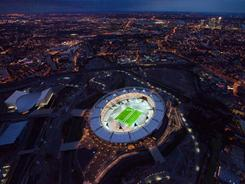 An aerial view of the London 2012 Olympic Stadium in east London on July 26, 2011, captures the beginning of the one-year countdown to the Olympic Games. Most carriers that fly trans-Atlantic routes allow you to purchase tickets 330 days in advance, so you could shop starting at the end of this week.