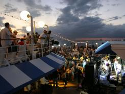 Passengers on the 2004 Jam Cruise dance while the Dirty Dozen Brass Band plays as the ship leaves Florida.