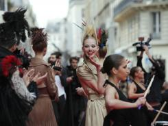 Models arrive for the Jean Paul Gaultier Fall-Winter 2011-2012 Haute Couture fashion collection presented in Paris.