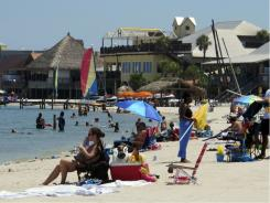 Beach towns from Alabama through the Florida Panhandle have had a strong summer 2011 rebound after a 2010 marred by tar balls, crude oil sheen and cleanup crews and equipment ruining the views for any would-be sunbathers.