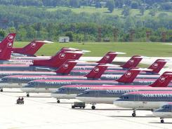 Northwest Airlines planes sit on the tarmac at Minneapolis-St. Paul International Airport after they were grounded on Sept. 11, 2001.