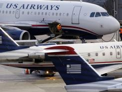 US Airways jets July 19 at Logan International in Boston.