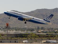 A United Airlines plane takes off from Sky Harbor International Airport in Phoenix. Air traffic controllers will move as many airplanes as they can as quickly as they can, which means they will move unrestricted airplanes to the front of the line.