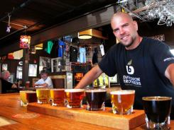 Bartender Jim Glenn serves a taster of craft beers at Oskar Blues, a Longmont brewery that became the first craft brewer to can beer in 2002.