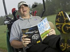 Gerald B. Steele, an avid golfer and business traveler, with a copy of &quot;Golf Magazine&quot; at Applewood Golf Course in Keysville, Ga.