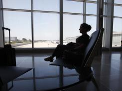 Carolyn Shaw of Toronto waits for a flight at Raleigh-Durham International on Aug. 28.