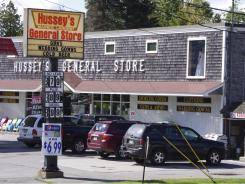 "At Hussey's General Store offbeat merchandise is a specialty. The sign out front says so, in no uncertain terms: ""Guns, Wedding Gowns, Cold Beer."""