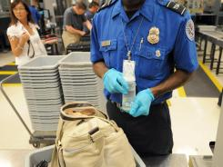 A Transportation Security Administration officer checks bags Aug. 3 at Hartsfield-Jackson Atlanta International Airport.