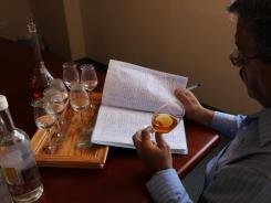 Roberto Pantoja, product quality director for Destileria Serralles, makes notes. He is a master rum blender.