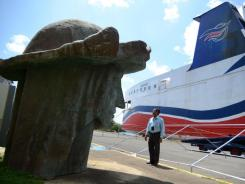 Tony Jacobs, director of the port of Mayaguez, looks at the head of a statue of Christopher Columbus, one of many pieces strewn across the port storage area in Mayaguez, Puerto Rico.