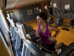 Lauren Walker works out on the treadmill at the Ritz-Carlton in Charlotte.