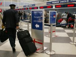 A United Airlines pilot walks to a security checkpoint at Chicago's O'Hare International Airport.