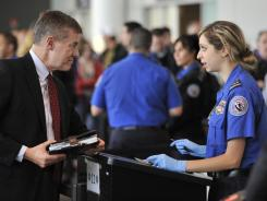 A TSA agent interviews a traveler in Boston as part of Logan International Airport's pilot program for enhanced behavior detection at airport security.