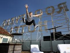 Dancing with the Stars professional Mark Ballas jumps in the air on the rooftop of the Roosevelt Hotel in Hollywood, Calif. Ballas especially appreciates the nightlife at the historic hotel.
