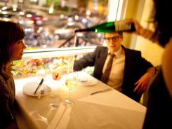 Sommelier Kathryn Bangs pours wine for patrons at Komi Restaurant in Washington, D.C.