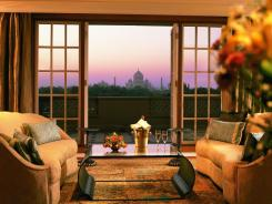 A window at the Oberoi Amarvilas in Agra, India, opens onto a view of the Taj Mahal.