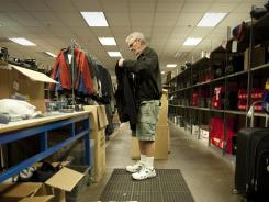 "Southwest Airlines Warehouse Supervisor Terry Tandy in the ""lost and found"" area of the airline's baggage facility in Dallas."