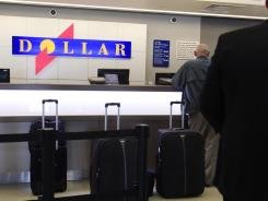 A Dollar rental car counter at San Jose International.