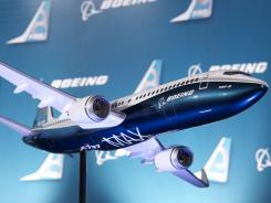 In this Aug. 30, 2011 photo, a model of Boeing's newly revealed 737-MAX passenger airplane is photographed in Renton, Wash. Lion Air, a large private carrier in Indonesia, ordered 201 of these planes.