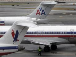 American Airlines planes are parked at a gate at New York LaGuardia Airport on Nov. 29, 2011.