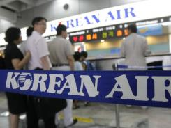 Fliers wait to buy tickets at the Korean Air ticketing counter at Gimpo airport in Seoul.