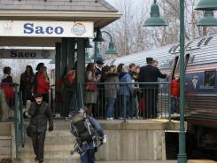 Passengers board the Amtrak Downeaster in Saco, Maine, on Dec. 9.