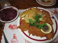 Weiner schnitzel, veal cutlets pounded very thin then breaded and fried, are perhaps the best known classic German dish, accompanied here by red cabbage and the restaurant's excellent hash brown potatoes.