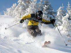 Wayne McCue of Revere, Mass., enjoys some of the powder in Warren, Vt., on Thursday.
