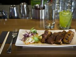 The unique spare ribs at Teton Thai are more of a country-style cut with a pineapple-based sauce. The eatery's bar churns out a large number of exotic cocktails.