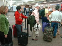 Fliers line up at a ticket counter at Asheville Regional Airport in western North Carolina.