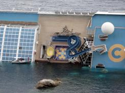The luxury cruise ship Costa Concordia leans on its side after it ran aground off the tiny Tuscan island of Giglio, Italy.