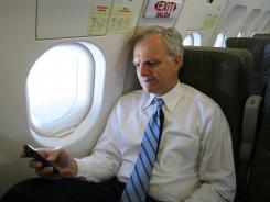 JetBlue founder David Neeleman on a wireless device during a 2007 media preview of a Wi-Fi equipped flight.