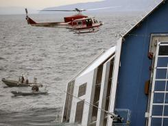 A helicopter and boat patrol near the Costa Concordia cruise ship on Monday in the harbor of the Tuscan island of Giglio.