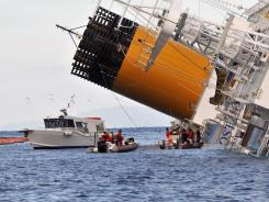 Ran aground Friday:  Emergency crews work on the cruise ship Costa Concordia off the island of Giglio, Italy, on Tuesday.