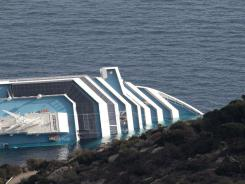The cruise ship Costa Concordia remains on its side Wednesday off the Italian island of Giglio.