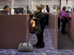 Non-resident visitors to the U.S. have their passports checked at McCarran International Airport in Las Vegas.