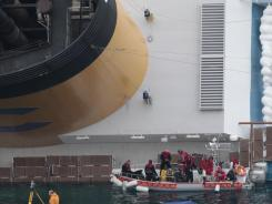 Rescuers work at the cruise ship Costa Concordia off the Italian island of Giglio on Thursday.