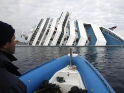 Italian firefighters approach the wrecked cruise ship Costa Concordia on Friday off the Tuscan island of Giglio.