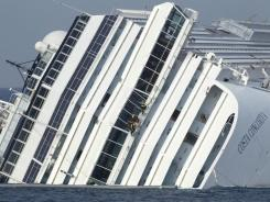 Italian firefighters work on a deck of the cruise ship Costa Concordia, grounded off the Tuscan island of Giglio, Italy, on Saturday.