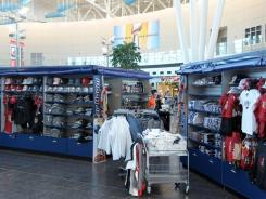 Indianapolis International Airport has makeshift Super Bowl XLVI merchandise kiosks set up in anticipation of the fans that will flood the airport. The New York Giants play the New England Patriots at Lucas Oil Field on Feb 5.
