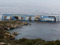 After a night of rough seas, a crack appeared in the Costa Concordia off Italy's coast. A sheen of oil coming from the ship's stern was spreading on Wednesday.
