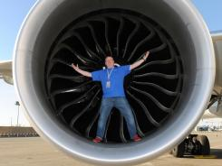 MegaDo's Tommy Danielsen inside an engine of a idled Cathay Pacific 777-300ER jet at LAX.
