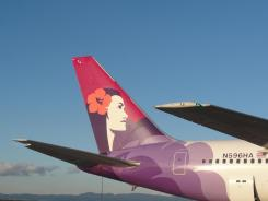 A Hawaiian Airlines jet sits at Oakland International Airport on April 8, 2011.