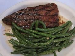 St. Elmo's classic strip steak with green beans. Virtually every athlete and celebrity who has visited Indianapolis has made a stop at the 110-year-old eatery.