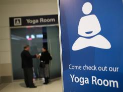 A sign in front of the new Yoga Room at San Francisco International Airport.
